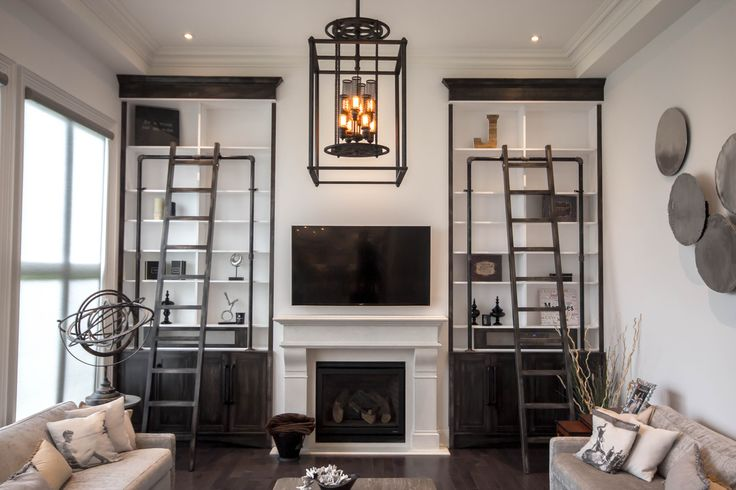 Our Hogan Built-In. These grand built-ins in an exclusive home in King City turned out perfectly. Made from solid Canadian Maple and beat up to look distressed brings life to this beautiful room. An excellent way to dress the large walls. Metal gas piping and custom ladders brings detail and esthetics to compliment the sheer size of these built-ins.