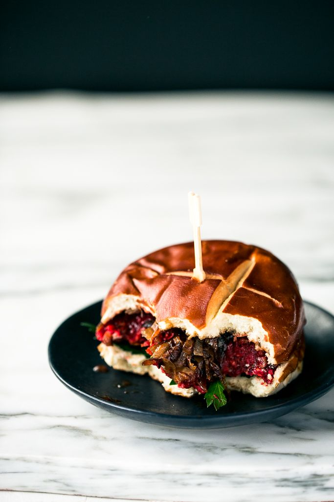 Smoky Vegan BBQ Beet Burgers | Smoky BBQ beet patties are tucked into puffy buns, slathered with BBQ sauce, and topped with caramelized onions.