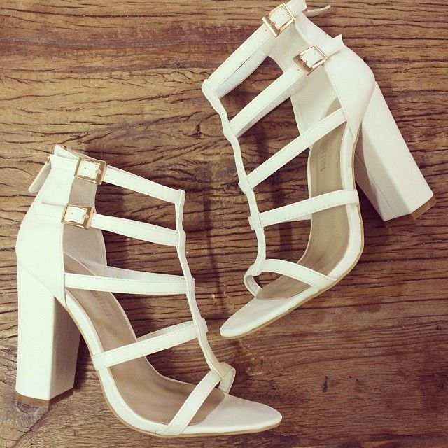 Simple yet eye catching white strappy heels