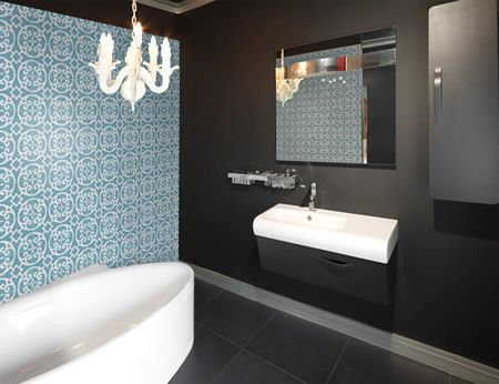 black bathroom with bright accent colours. Like how the cords on the  pendants coordinate with