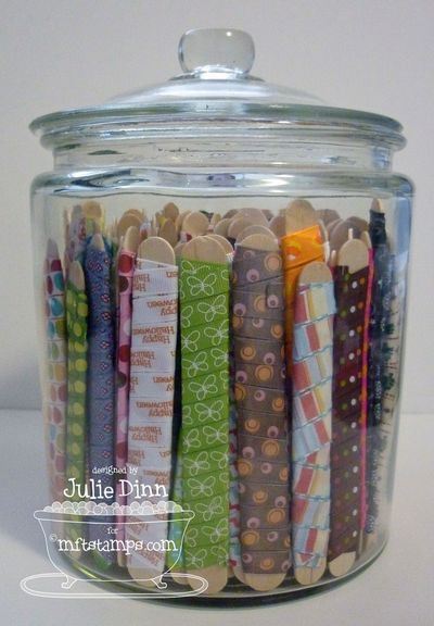 Ribbons on large crafts sticks to save space? Wonder if the ribbons might end up too kinked?  If not, could be a great idea.
