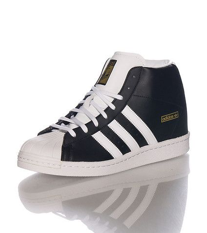 adidas+Mid+top+women's+sneaker+Lace+up+closure+Premium+leather+upper+Signature+triple+adidas+stripes+Cushioned+inner+sole+for+comfort+Rubber+outsole