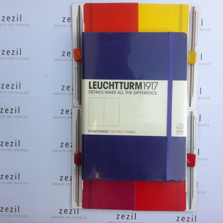 Lila színű Leuchtturm1917 A5-ös méretű ponthálós jegyzetfüzet narancssárga, citromsárga, málna színű és piros tolltartó gumival.  Leuchtturm1917 | pen loop | zezil