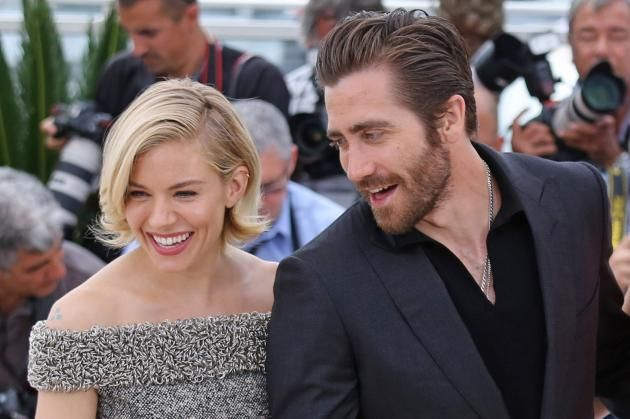 Jury members Sienna Miller (L) and Jake Gyllenhaal arrive at a jury photo call during the 68th annual Cannes International Film Festival in Cannes, France on May 13, 2015. Photo by David Silpa/UPI