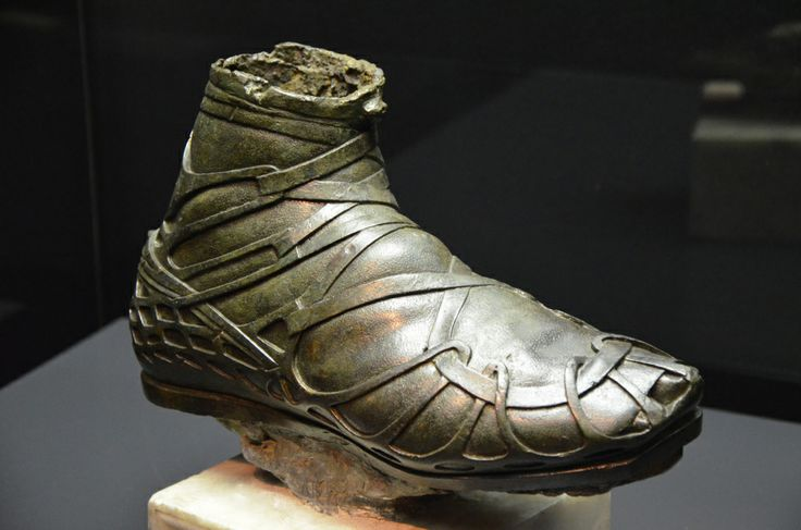 Caligae were heavy hob-nailed military boots worn by the Roman legionary soldiers, auxiliaries and cavalrymen throughout the Roman Republic and Empire.  This bronze caliga was part of an over life-size statue of a Roman cavalryman from the 1st or the 2nd century AD. It is exhibited at the Museo Civico Archeologico of Bologna.