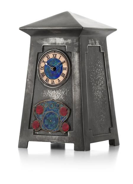 ARCHIBALD KNOX (1864-1933) FOR LIBERTY & CO., LONDON 'TUDRIC' PEWTER AND ENAMEL CLOCK, CIRCA 1902 the circular copper and enamel dial with...