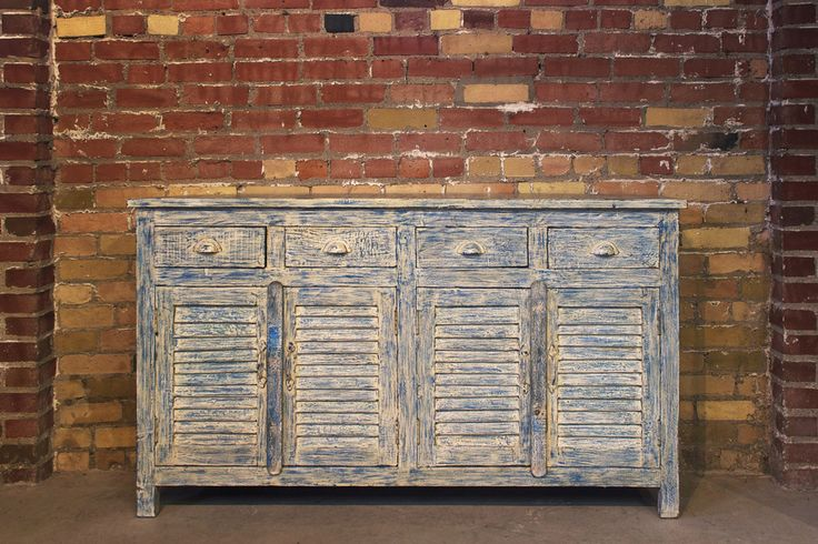 """Recent Reclaimed Teak Buffet $1495 Blue and white shutter door reclaimed teak with antique distress paint and brass handles Sourced from Rajasthan India Height - 36"""" Width - 63"""" Depth - 16"""""""