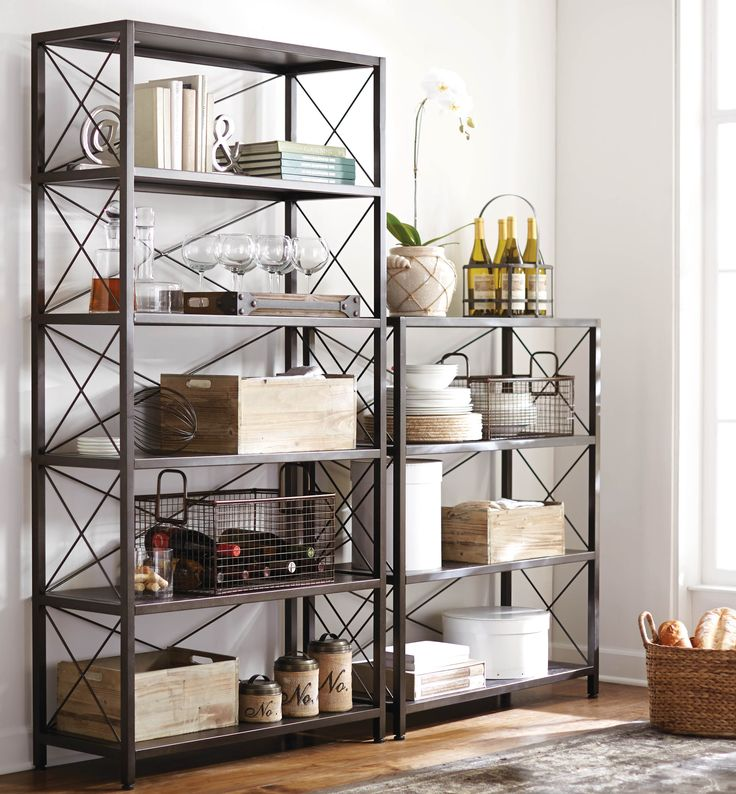 A metal open bookcase is beyond functional. We like how this one works as a place to store dinnerware. HomeDecorators.com #storage