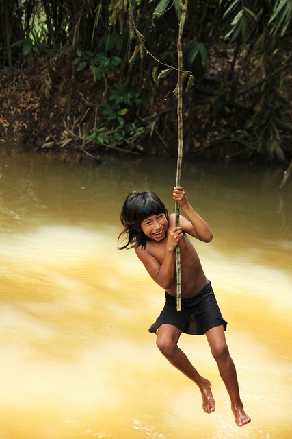 Awá girl, Brazil.  | My grandfather created the most amazing rope swing for me, back in the day.  Looking back, I was a fearless little girl. :)