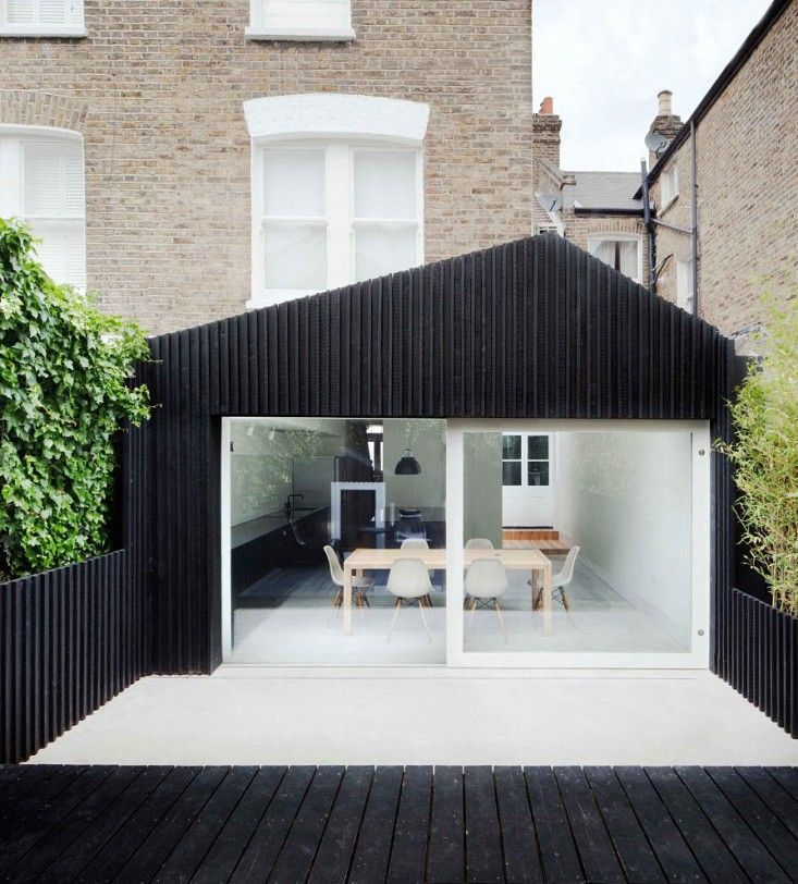 Gundry & Ducker Architecture used black stained larch boards in the siding, decking, and fencing of their modern expansion project at Dove House in London. Photograph by Joe Clark.