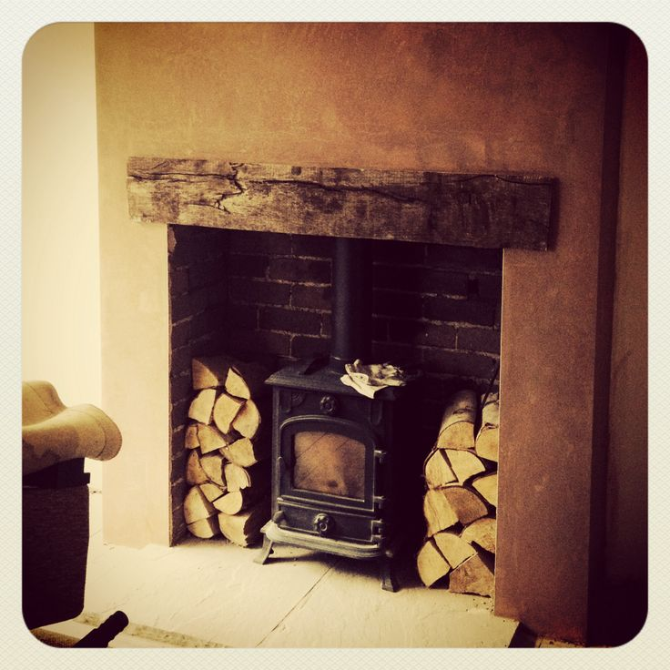 Fire place progress! Log burner with wooden lintel.
