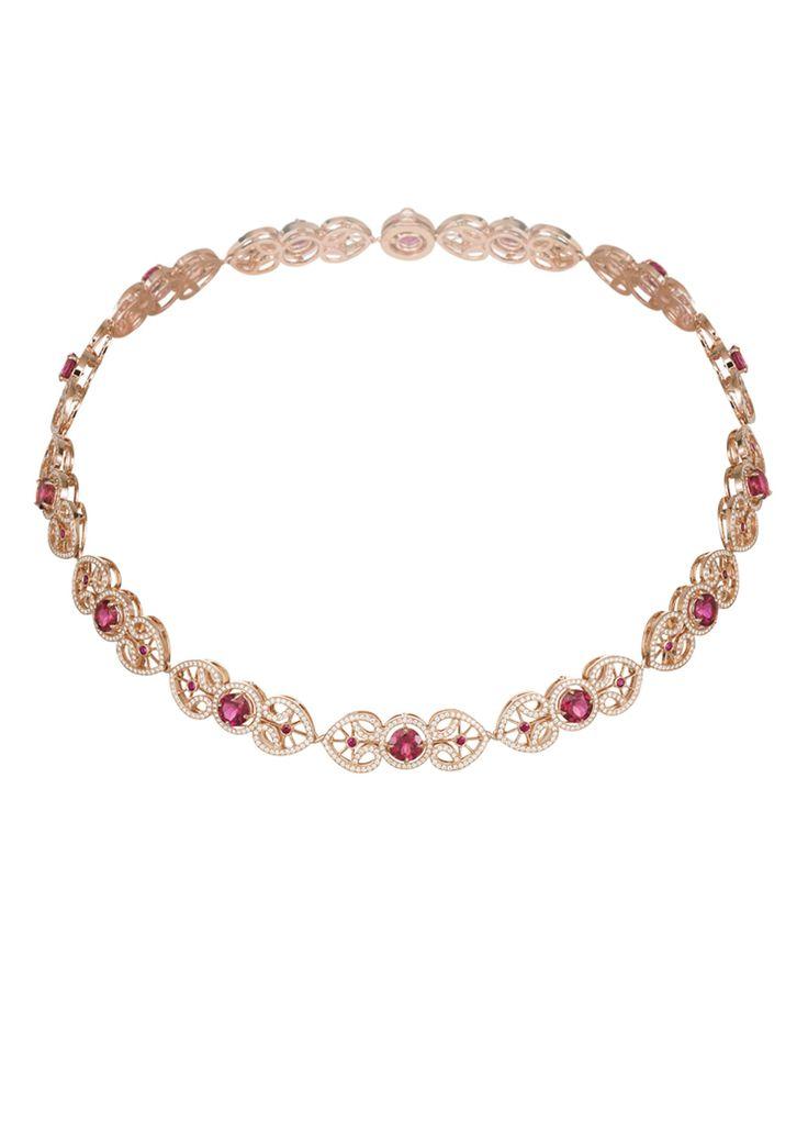 Designed as pavé-set diamond interlocking heart-shaped motifs, each holding a round rubellite in diamond surround.