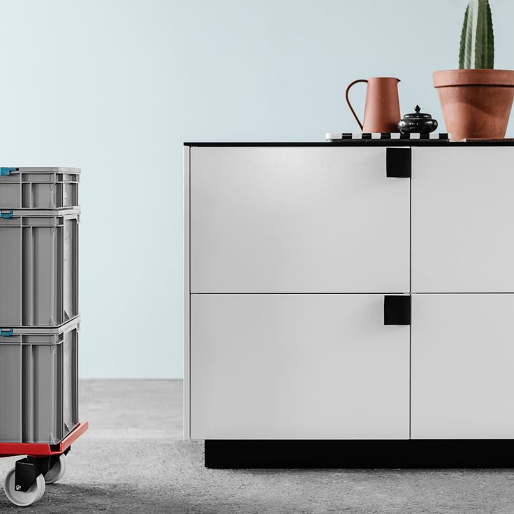 The Reform kitchen hack by BIG, Bjarke Ingels Group, is defined by its handles, which are made from the same fabric used to make seat belts.