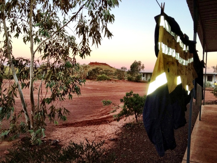 FIFO stands for Fly In Fly Out. Workers fly to the mine and stay on site for 1 or two weeks, working 12 hour shifts each day. This mine worker has their washed work shirts hanging out to dry at the remote mine site on the Pilbara. This cabin is on the edge of the village. Over the horizon is thousands of miles of arid bush. They say that iron ore miners have red dirt in their veins. One thing is for sure, working in the Pilbara leaves an imprint that you will never forget