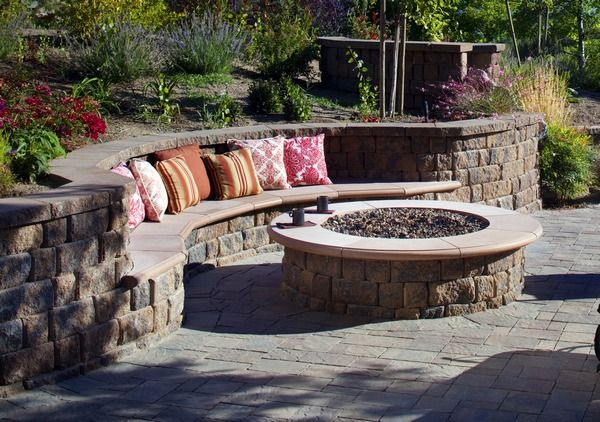 curved built-in bench in retaining wall.  I like the shape, but would chose different materials.