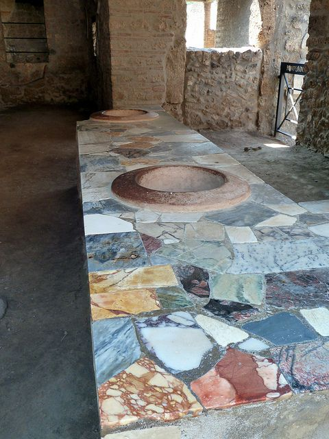 """pompeii and herculaneum display of The view inside pompeii's old granary (francesco lastrucci)  as recently as  2002, archaeologists meeting in rome said herculaneum was the """"worst  example."""