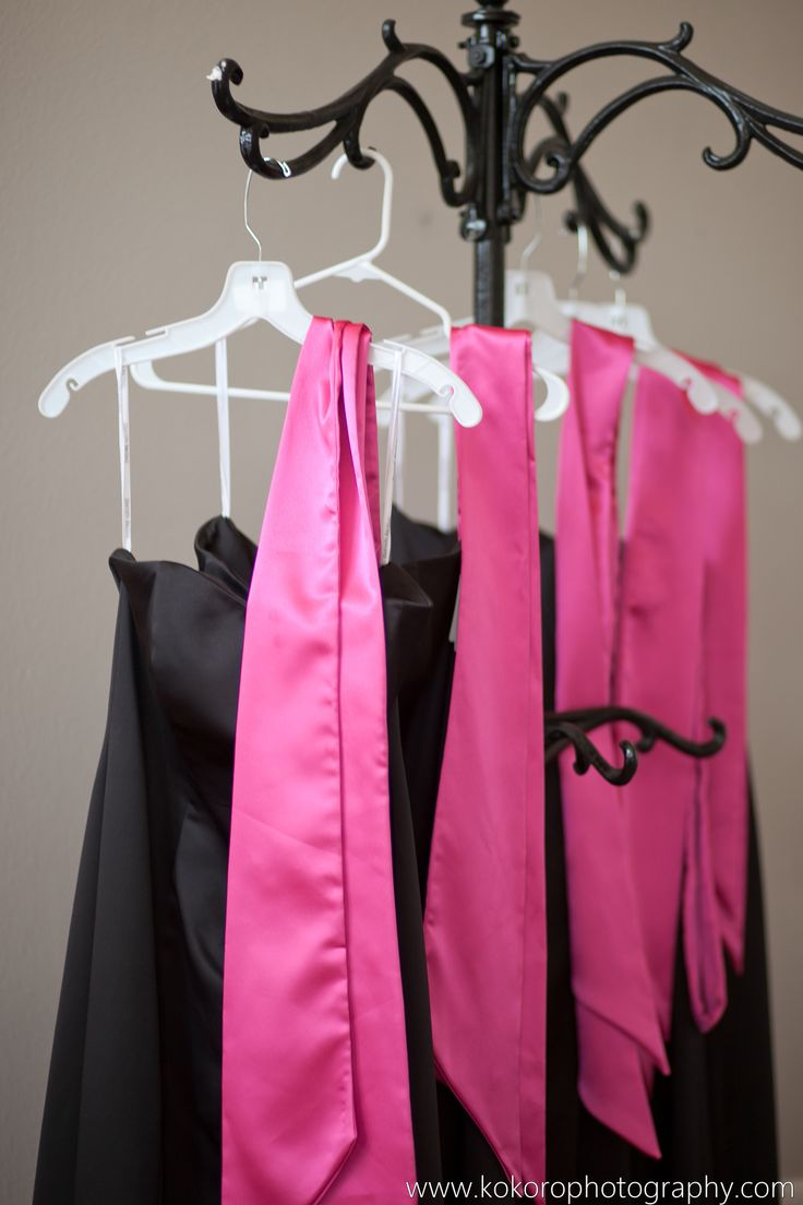 Bridesmaids black A line strapless dresses with hot pink sashes. Wedding Planning by MuseEvents.com