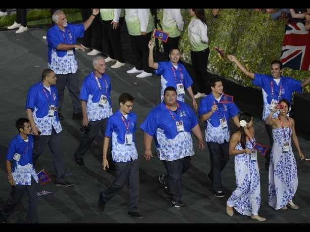 July 27, 2012; London, United Kingdom; Guam athletes walk behind the flagbearer during the Opening Ceremony for the 2012 London Olympic Games at Olympic Stadium. Mandatory Credit: Richard Mackson-USA TODAY Sports.  Credit: