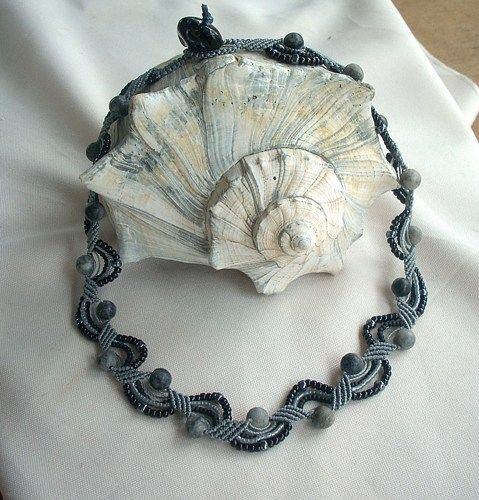 I made this necklace using gray c-lon cord. I used shades of black and luster gray seed beads. It also had 8mm black and gray marbled stone beads. The loop and closure has a black agate bead. It is 18