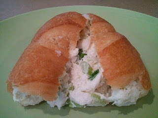 HOT CRAB ROLLS	   1 lb. lump crab meat or 2 to 3 cans  1 c. diced celery  1/4 c. diced onion  1 c. shredded Swiss cheese  3/4 to 1 c. mayonnaise  12 to 18 rolls  1/4 c. butter, melted  Combine first 4 ingredients, fold in mayonnaise. Slice rolls in half. Brush inside of rolls with melted butter. Fill with crabmeat mixture. Wrap each separately in foil. Bake at 400 degrees for 15 minutes.