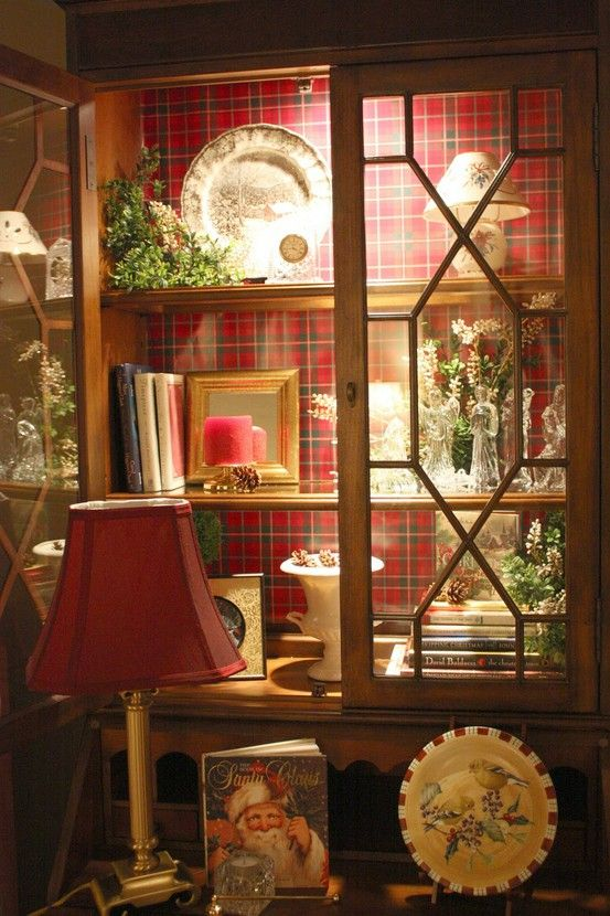 Beautiful way to temporarily decorate a hutch or bookcase for Christmas using wrapping paper as a backdrop and inside lighting