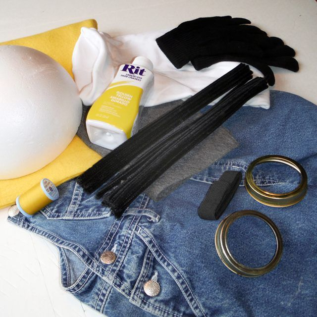 Recycle a pair of overalls from your closet or a thrift store and find a yellow shirt or sweatshirt in bright yellow. You will also need a pair of black gloves, some bright yellow fleece, gray felt, black fabric, black pipe cleaners, spray adhesive, 2 canning rings, black elastic and an 8-inch styrofoam half circle. Additionally you will need some...