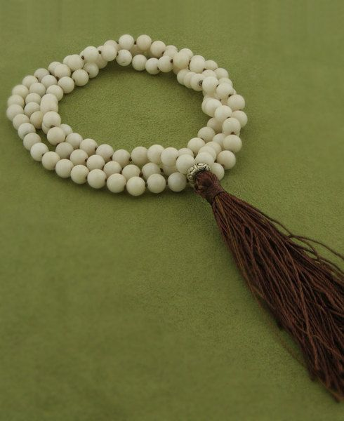 Meditation mala made of white jade with individually knotted beads. Meditation supplies available at BuddhaGroove.com.