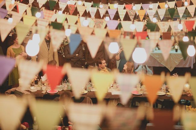 Bunting and twinkle lights via Green Wedding Shoes.