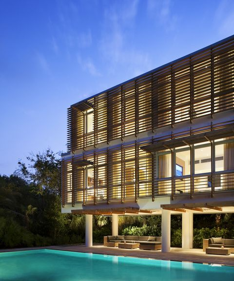 Modern louvered facade in ipe wood to a beach house in Sullivans Island, South Carolina, by Stephen Yablon Architect.