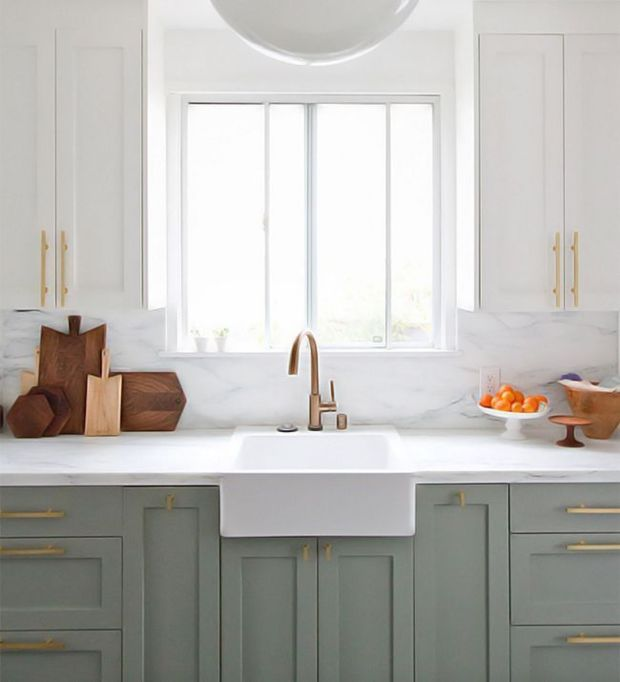 All eyes on this picture-perfect, whitewashed setting complete with a marble backsplash, sleek brass pulls, and an equally stunning shade of gray. More
