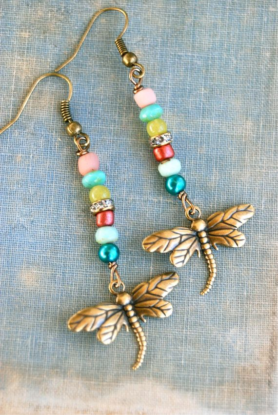 So colorful and fun! features assorted glass beads,rhinestone bead,pearl,crystal charm, antique brass dragonfly charm,antique brass chain Pendant drops 2 from the chain.Necklace finishes with a lobster claw. { earrings sold seperately in the shop}