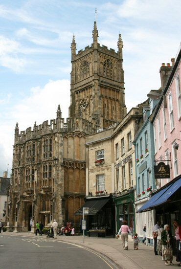Market Place and dating from 1115 St. John the Baptist Church, Cirencester, Gloucestershire, England