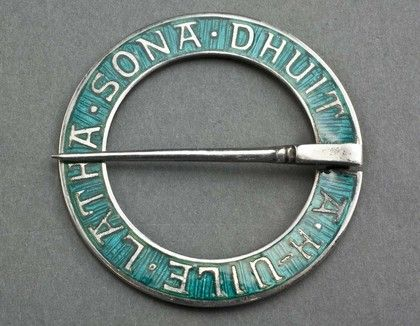 "A rare silver and green enamel annular brooch designed by Alexander Ritchie, the famous Iona silversmith. The brooch has a Gaelic inscription ""A h-uile latha sona dhuit"", translated ""May all your days be happy"". These brooches are traditional wedding presents to celebrate a marriage. The Alexander Ritchie website (see our links page) shows 2 similar brooches, one in blue and the other in red enamel, both are described as rare, they do not show a green enamel example. Ritchie began to use the…"
