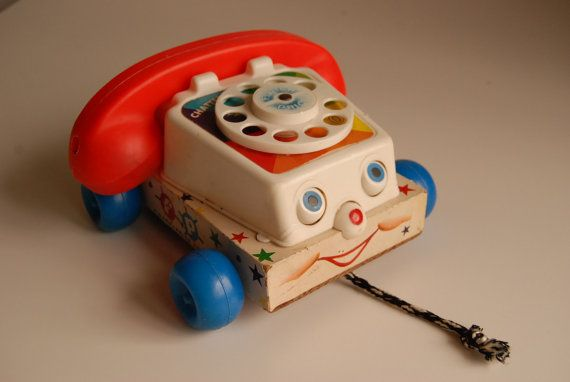 This Fisher- Price Chatter Pulley Telephone is great fun for children. Made in USA.