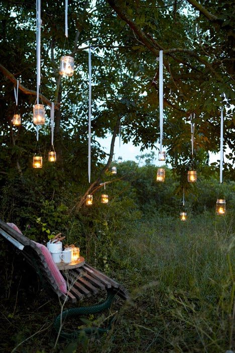 Hanging mason jars with candles, could do diff colored ribbons, diff colored candles, or even dyed water