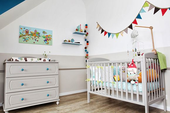 cute nursery with white, grey, and bright colors