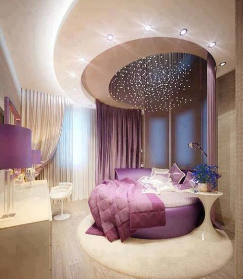 Circular bed with matching ceiling detail.