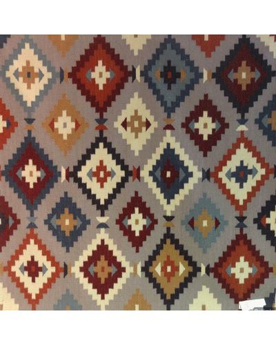 Add some colour and interest with a patterned geometric kilim