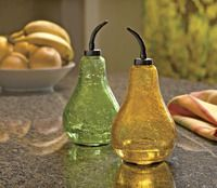 """These beautiful kitchen additions are both effective and discreet. Fruit flies enter through the bottom of this crackle glass pear and can't fly out. Every two weeks, rinse and add fresh lure – no plastic traps to throw away. Includes three packets of non-toxic lure. •Recycled crackle glass, metal, 3 non-toxic fruit fly lures •Lures contain yeast, sugar and other natural ingredients •4"""" in diameter x 8"""" H •Keep out of direct sun"""
