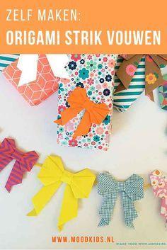 Een papieren origami strik wordt een broche, slinger of extra versiering op je cadeau! Vouw deze strik via de stap-voor-stap foto uitleg.