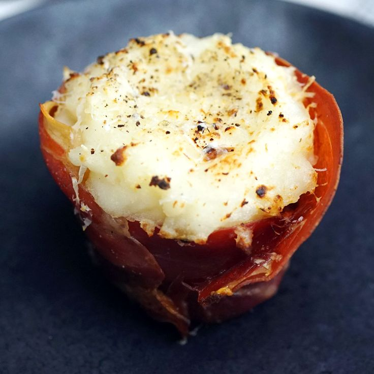 The tastiest way to serve meatloaf is by stuffing it into little prosciutto cups and topping it with mashed potatoes.