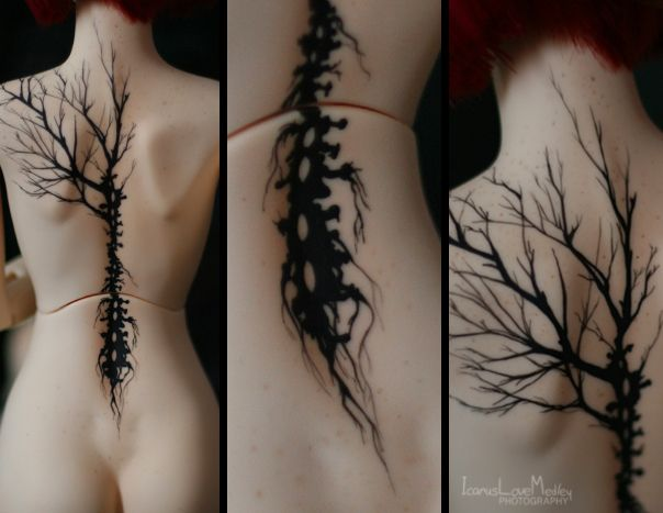 half back tree tattoo with spinal roots