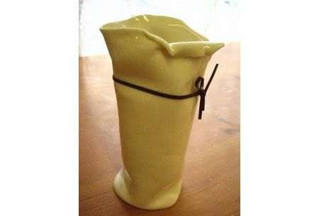 """This white porcelain Vase is inspired by the ancient leather wine skin, this """"floppy"""" handmade glazed, white porcelain Vase is decorated with a faux leather bind. Giftboxed. http://www.marketdirect.ie/Wine-Skins-Vase"""