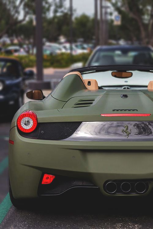 military green ferrari 458 italia spyder... I know I will never get the chance to own one of these.. But here's to dreaming!