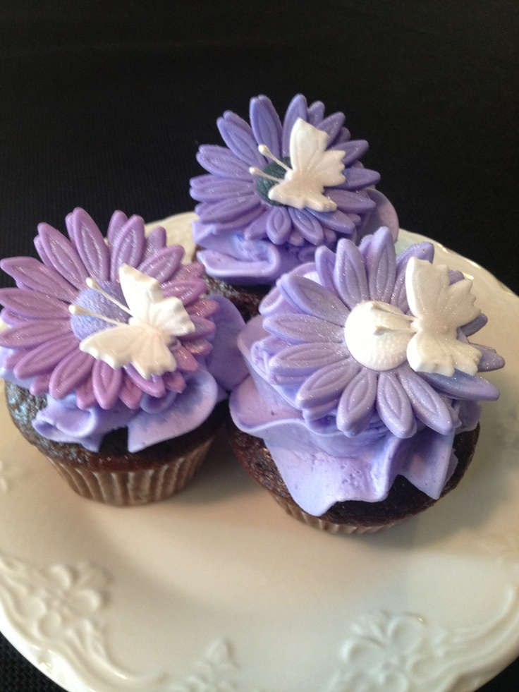 Purple Flower Cupcakes - BC and fondant. Just some flowers, butterflies and BC I had left over. TFL