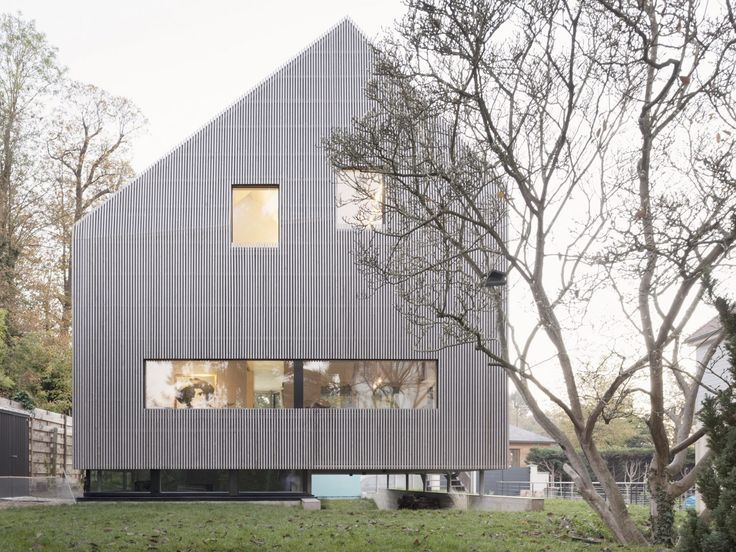 Grey larch covers prefab Marly House designed by Karawitz to bring city feel to Paris suburbs