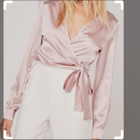 Shop Women's Missguided size 4 Blouses at a discounted price at Poshmark. Description: Pink satin tie around blouse! Super cute for any occasion, new with tags! Would fit about a 34 C bust, a little too big for me. Long on the arms and doesn't tie around too snug.. Sold by angelinaap. Fast delivery, full service customer support.
