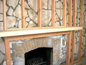 Want to get rid of an old rock wall but it requires too much demo? Cover it up with framing and drywall.