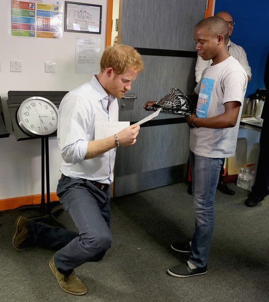 Prince Harry is presented with gifts by 16 year-old Relebohile 'Mutsu' Potsane ( who Prince Harry has stayed in touch with since they first met during his first visit to Lesotho in 2004) who is singing as part of the Basotho Youth Choir, made up of six boys and six girls, aged between 7 and 19 years old at the Brit School on June 27, 2016 in London, England. The Basotho Youth Choir will perform alongside Sentebale Ambassador Joss Stone at tomorrow's Sentebale Concert at Kensington Palace…