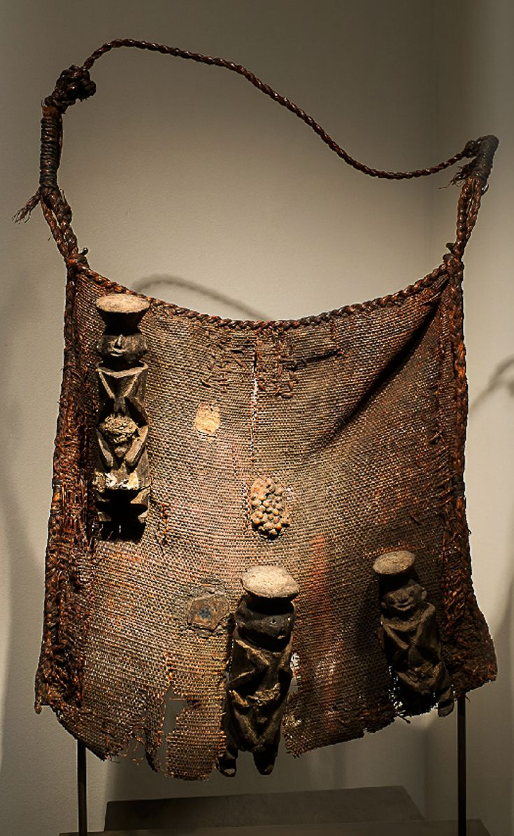 Africa | Diviner's bag from the Chamba people of Nigeria | Natural figure and wood || November 2013 Catalogue, pg 43